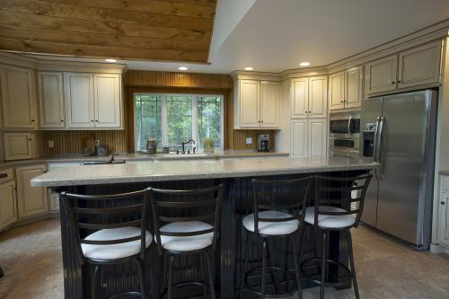 Custom made kitchen island with cabinets in the background